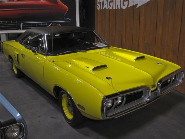 1970 Coronet R/T finished in Lemon Twist, with a 440 CID 4 BBL, and a pistol grip factory four-speed manual. It has both a Black Vinyl Top, and Poverty Caps… and is one of only 440 R/T's produced with the 440 4 BBl and 4-speed combination