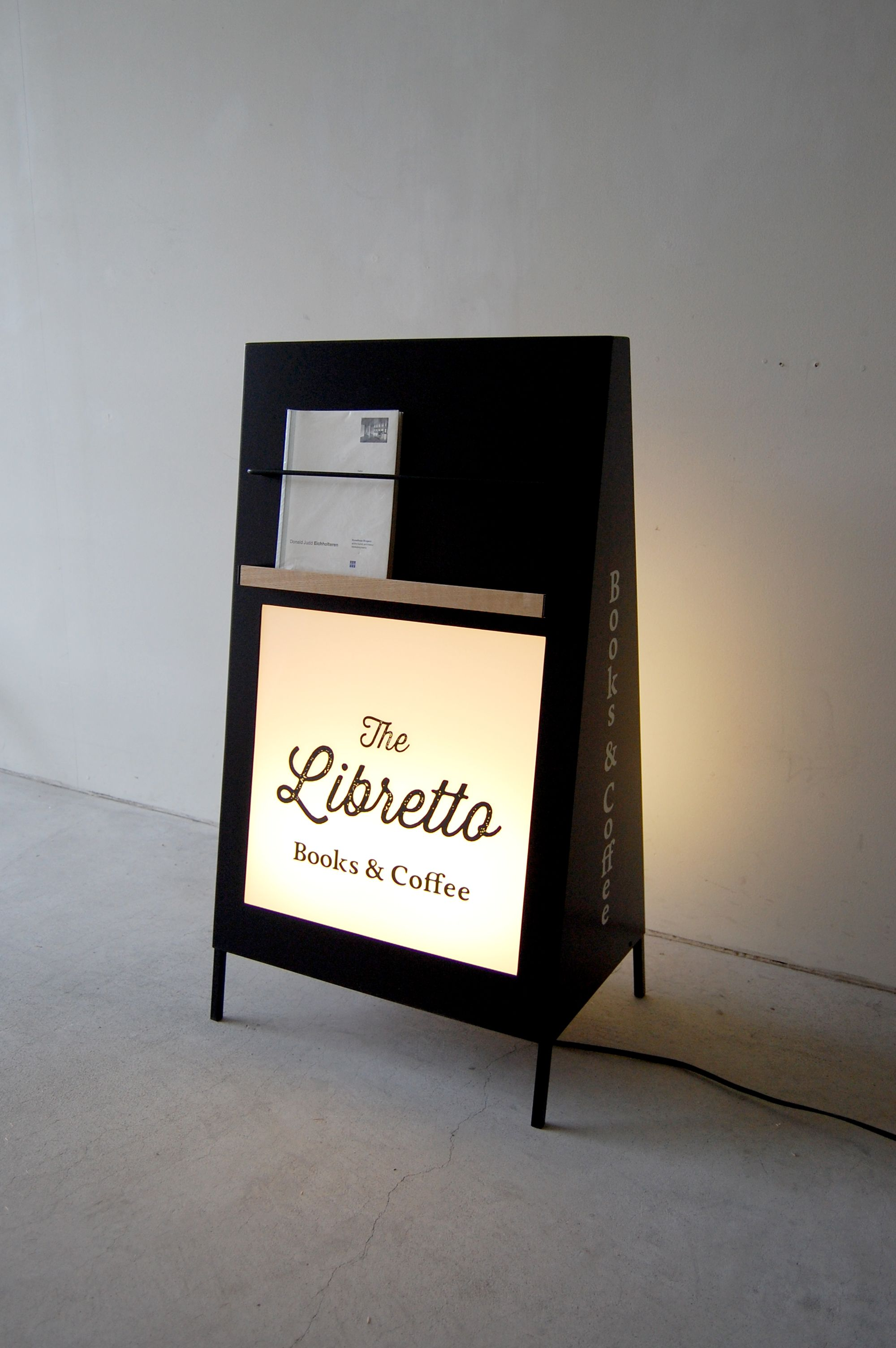 592f7b1261 illuminated shop stand sign- Is that an actual libretto on there or am I  being led on by a fool s fancy