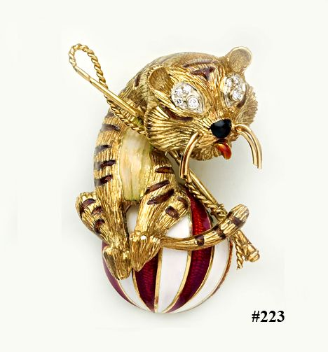Enamel, diamond and carved gold circus tiger brooch.  Cartier.