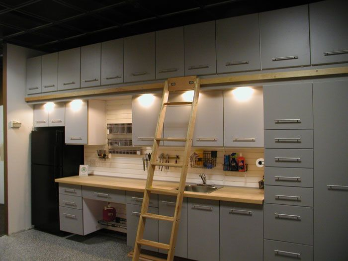 custom garage storage cabinets and slat wall storage on garage organization ideas that will save you space keeping things simple id=25094