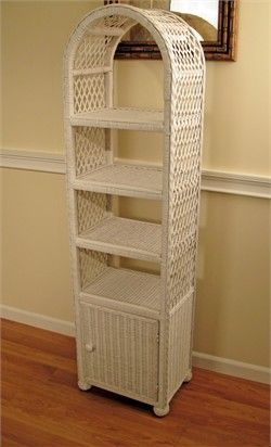 Elana round top wicker etagere with door  17w-12d-63h. This piece is ideal for bathrooms or any room where you need extra storage within a small space. Features 4 open shelves and 1 behind the doors. Ships in 1-2 days.