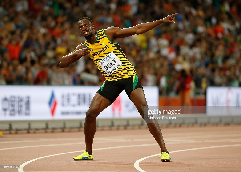 Usain Bolt of Jamaica celebrates after winning gold in the ...