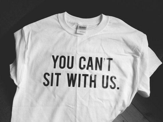 you can't sit with us mean girls tshirt famous movie by sillyteez #whitetshirt #tshirt #tshirts #text #quotes #texttshirt #quotestshirt #fashion #style #clothing #tumblrfashion #tumblr #gift #gifts #giftideas #giftideasforher #giftidea #white #black #blackandwhite #minimal #bandw #b&w