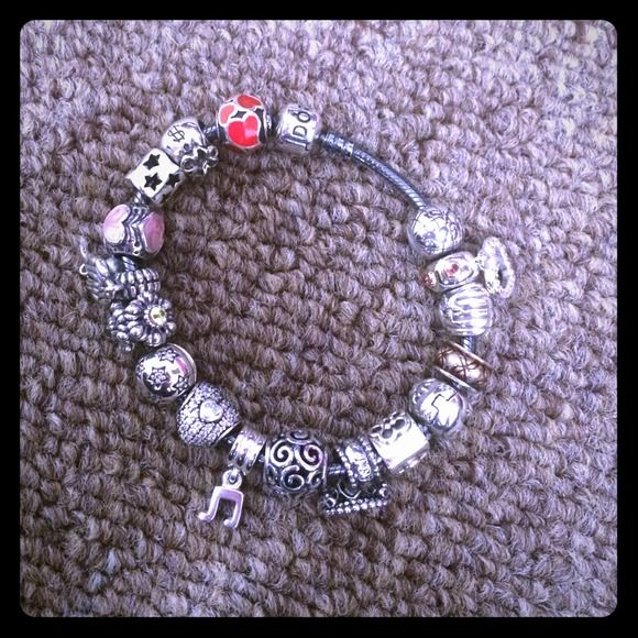 Pandora bracelet 💕 I'm selling all the charms there basically brand new I know all the prices 💕 so lemme know witch ones you like an would like to buy 💕👍 Pandora Jewelry Bracelets