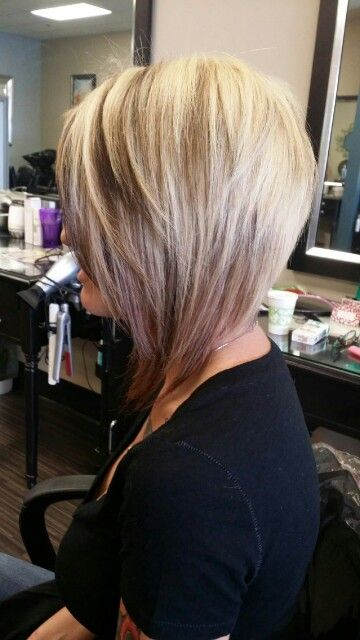 Blonde with pink highlights asymetrical bob by Hristiana in Jacksonville,Fl