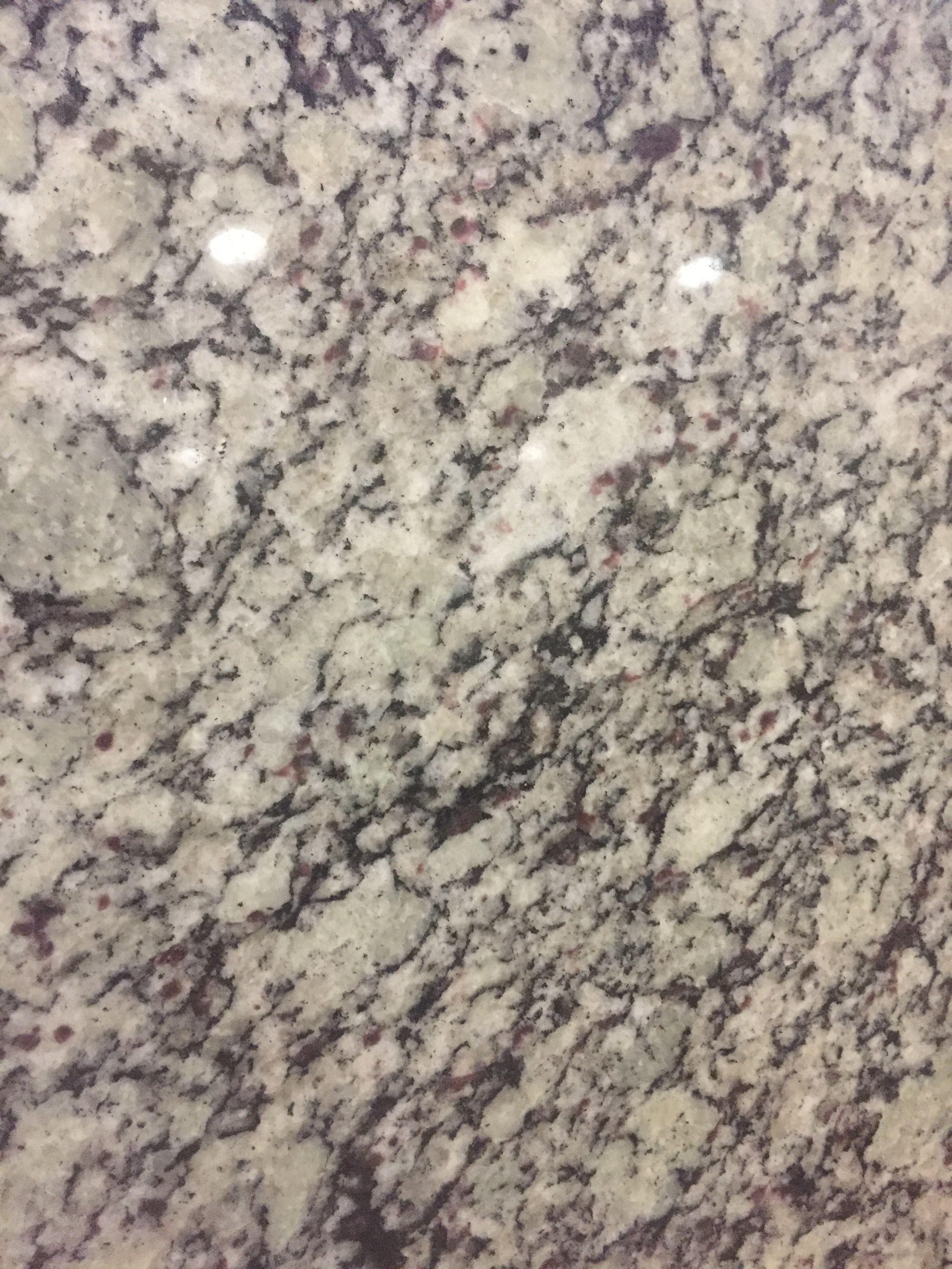 Primata White Granite #countertop #countertops #granitecountertops #quartzcountertops #naturalstone #bathroomdesign #bathdesign #bathroomdesigners #kitchendesign #goodfellasgranitellc
