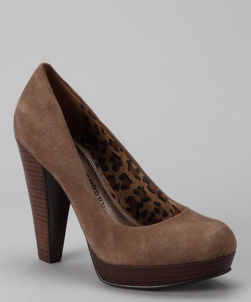 Pump up the volume with this polished pair. These playful platform heels add some sizzle to any professional or dressy ensemble with a supple suede material, chic hue and classic round-toe silhouette.4.5'' heel with 0.5'' platformSuede upperMan-made soleImported