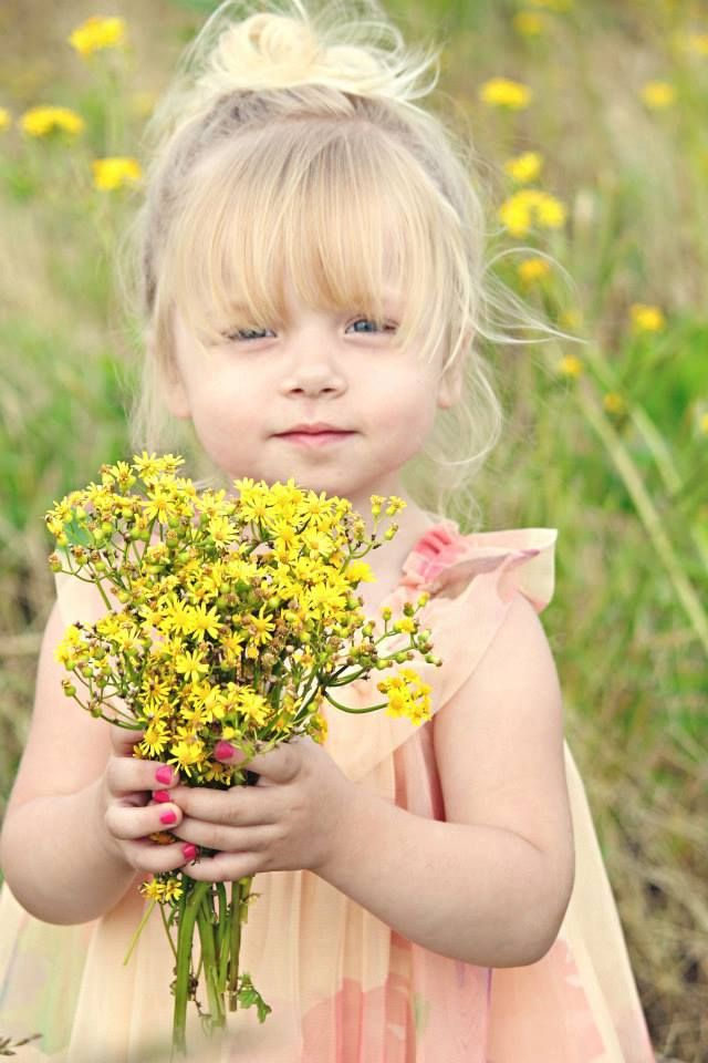 children photography. little girl in field of yellow