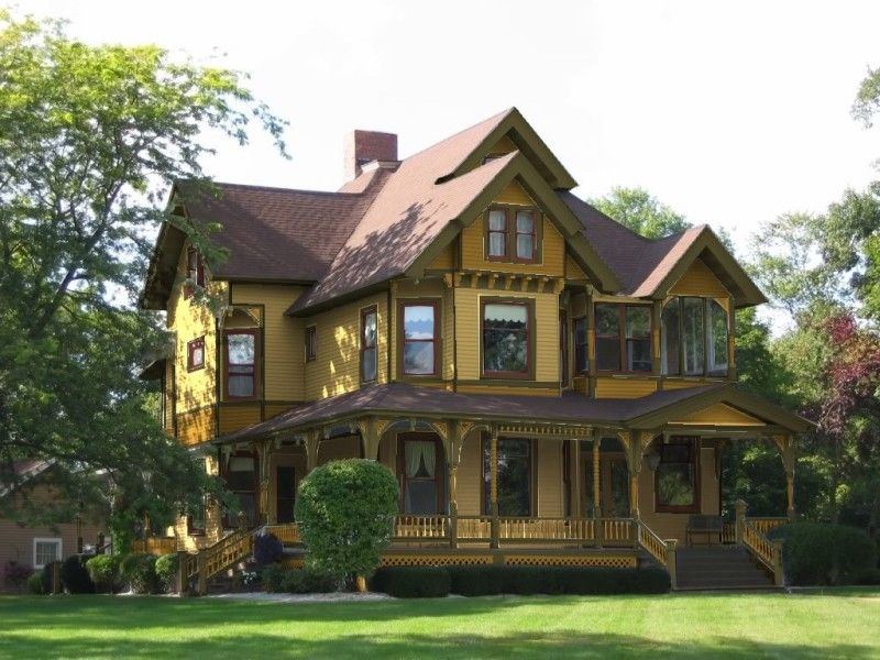 House Yellow House Exterior Color Schemes With Brown Roof And - Brick house colors with dark brown