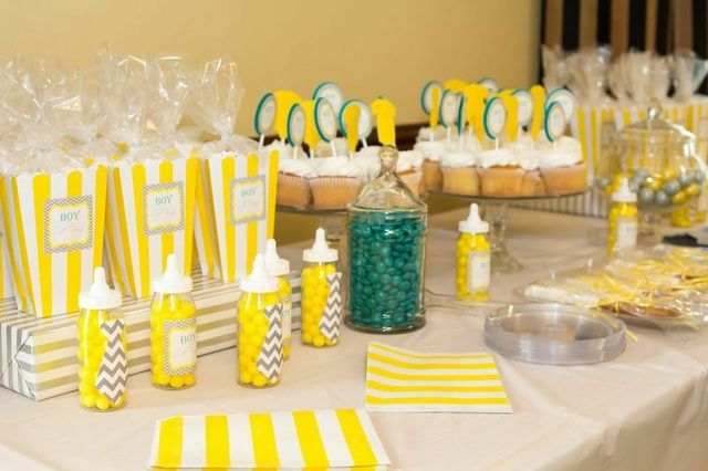 yellow and gray themed dessert table at a baby shower see more party