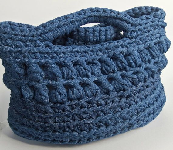 Coarse  crochet basket made of t shirt yarn. The basket has the structure and color of real jeans.