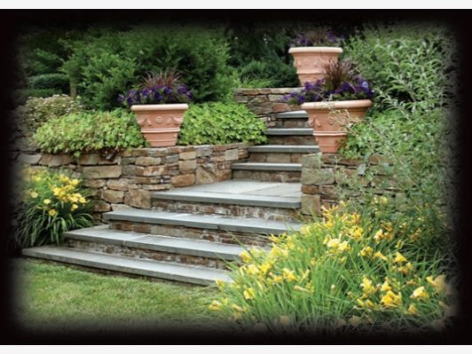 Outdoor Stone Stairs With Flowers And Plants On Either Side.   Home And  Garden Design