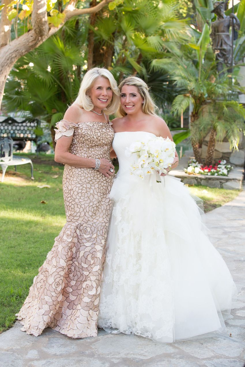 The motherofthebride wore a floral, taupe gown