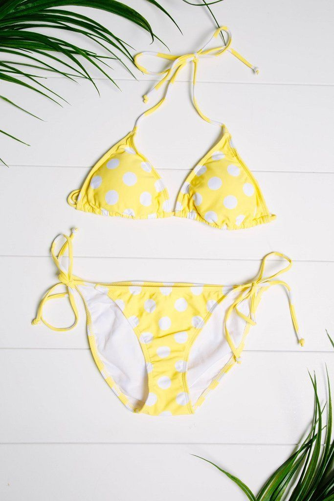 Strut your stuff in our adorable yellow polka dot bikini that highlights your tan and toned body! This two piece has adjustable string ties with irresistible structure and support.