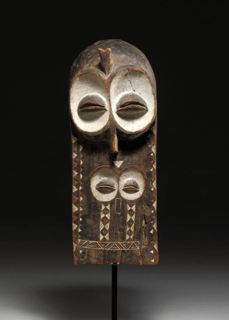 Africa | 'Eluba or  Emangungu' mask from the Bembe people of DR Congo | Wood with areas of red and white pigment | ca. 1957 or earlier