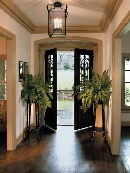 Beautiful antique french doors opening into a simply - Lighting ideas for halls and foyers ...