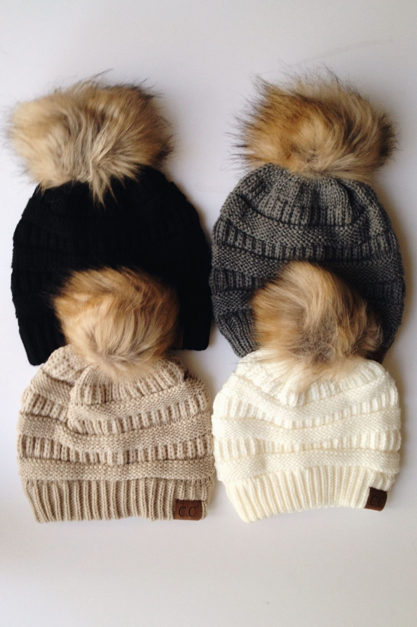 4ee98b3db84e9b Pom knit CC Beanie available in four colors: beige, ivory, gray, and black.