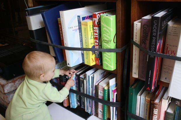 Baby Proofing A Book Shelf Using Bike Tire Innertubes