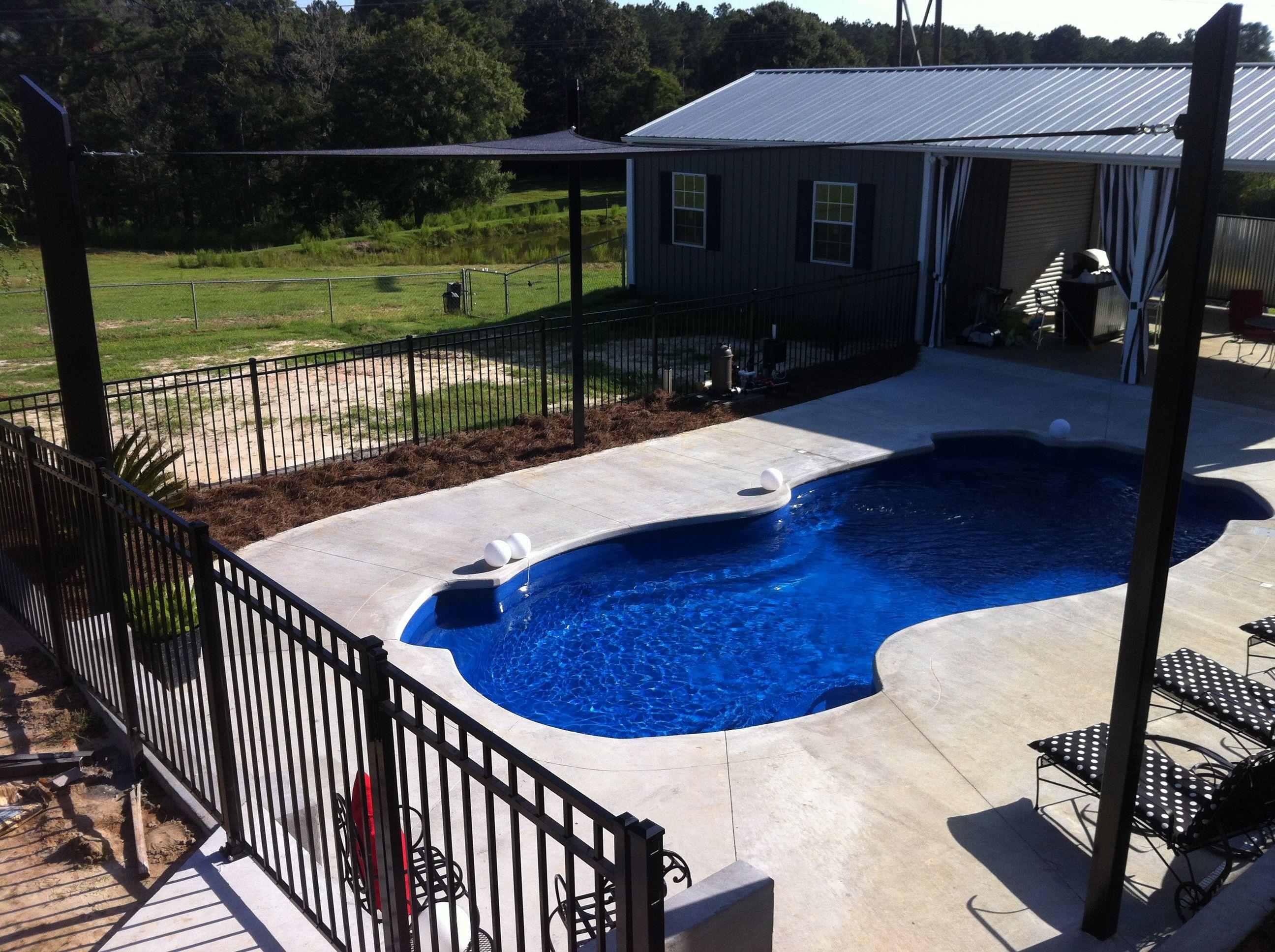 Shade Sail and sunpools fiberglass pool with retaining wall ...