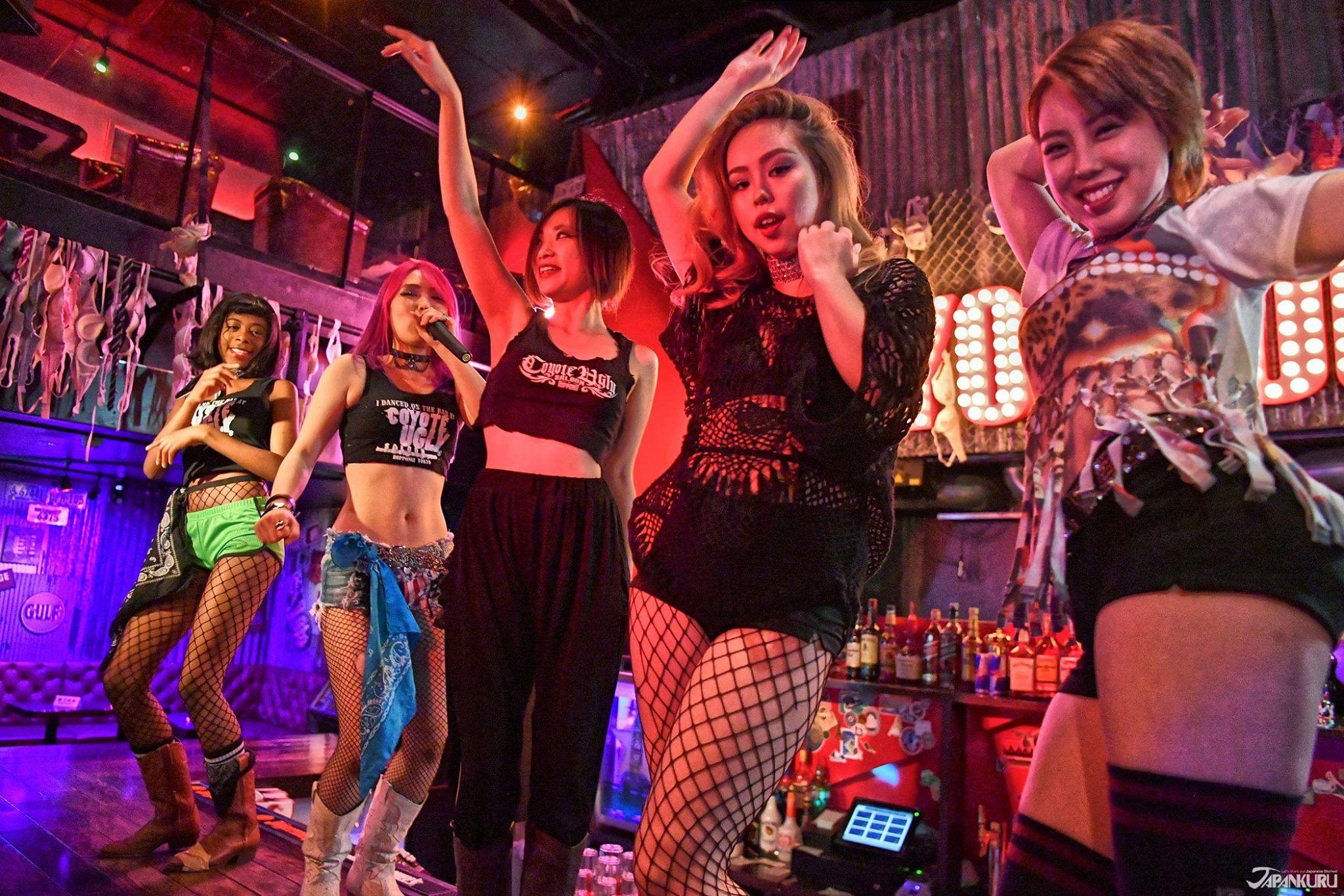 Sexy girls dancing in club