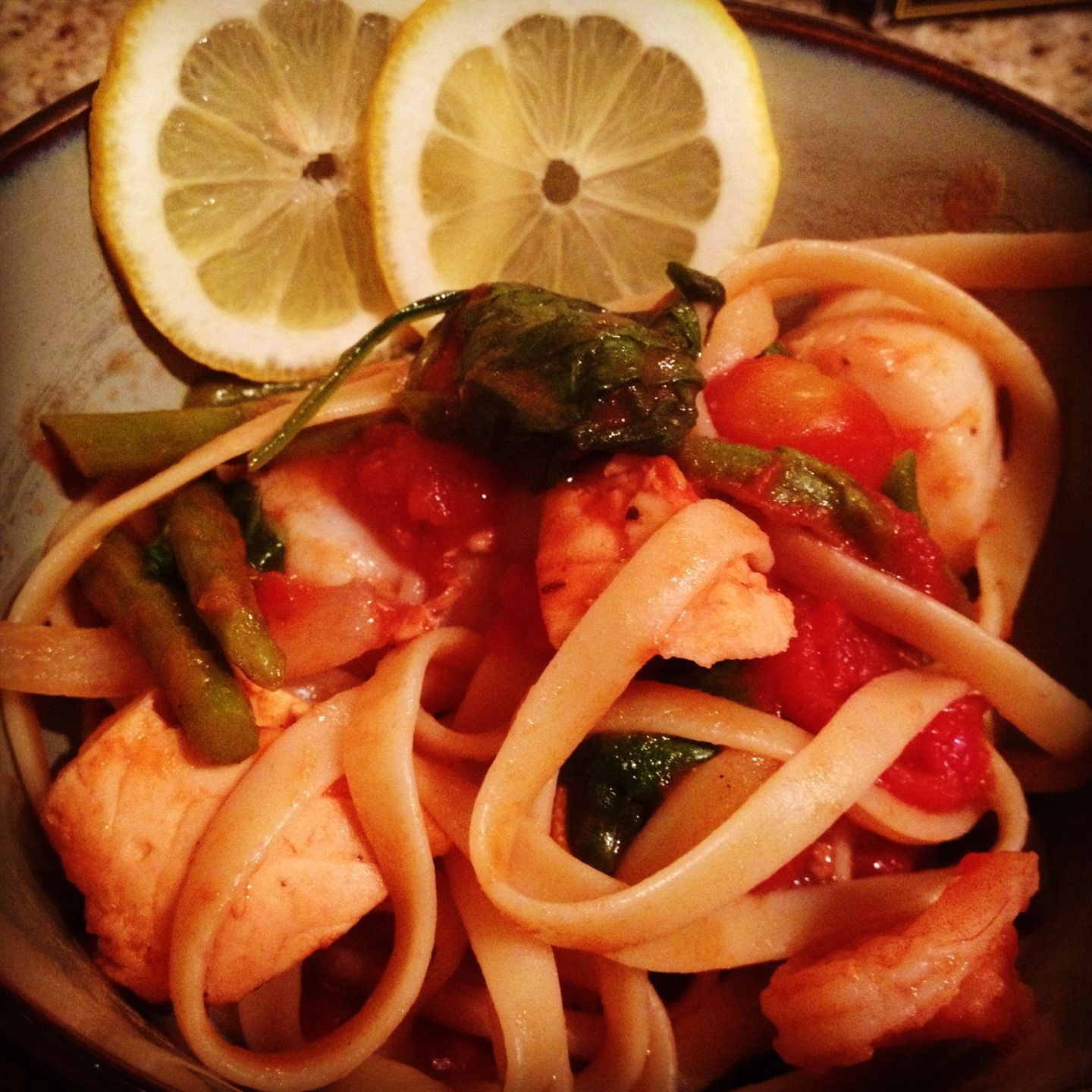 Seafood pasta! Made with shrimp, salmon, and scallops plus spinach and asparagus in a light tomato sauce! Easy, healthy, and yummy!