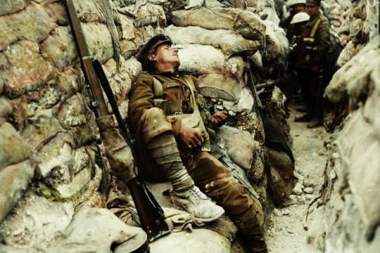 An exhausted British soldier asleep in a front line trench at Thiepval, Somme. September 1916.