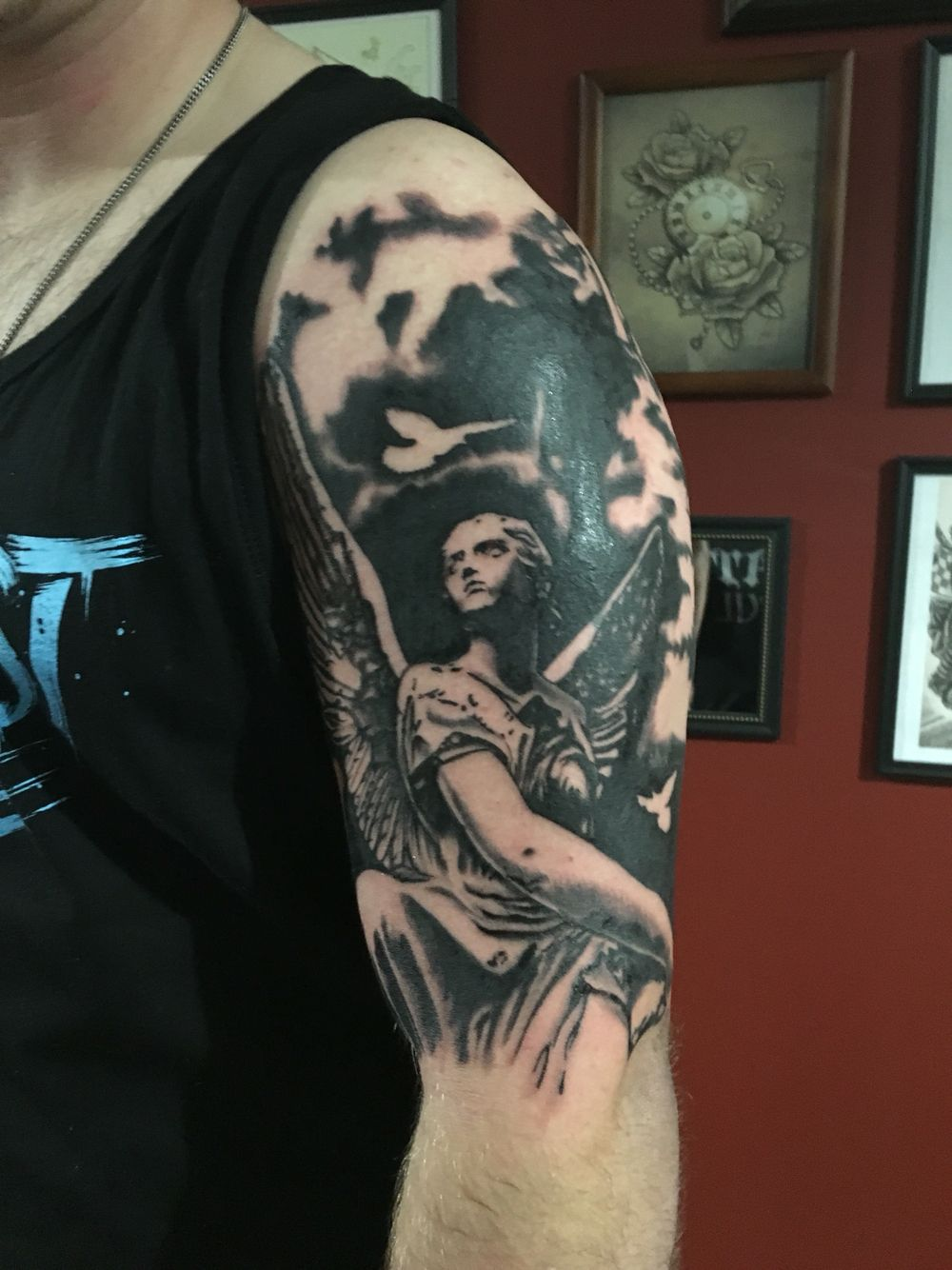 ad101e9e7 A black and grey angel tattoo on the shoulder by Joshua Nordstrom at Deft  Tattoo Studio