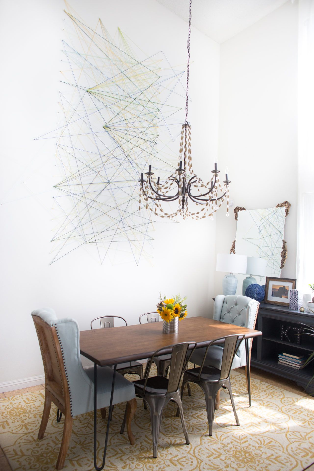 Make Your Dining Area Into A Special Space By Hanging Chandelier Mixing Chairs