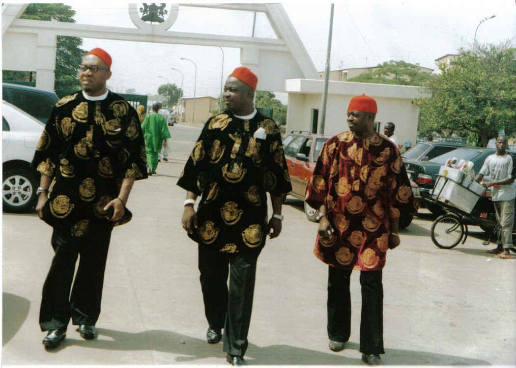 Igbo men (characterised by the red cap)