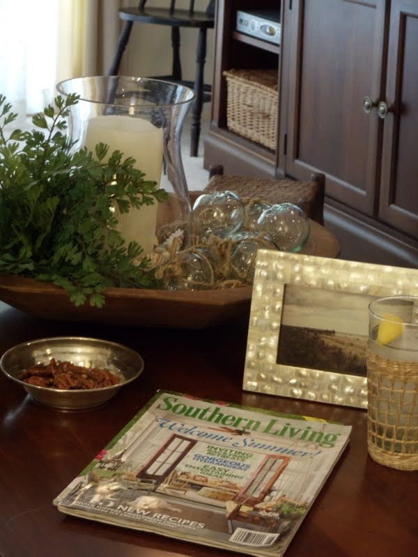 Southern Coffee Table Vignette With Glass Floats And Pecans In A
