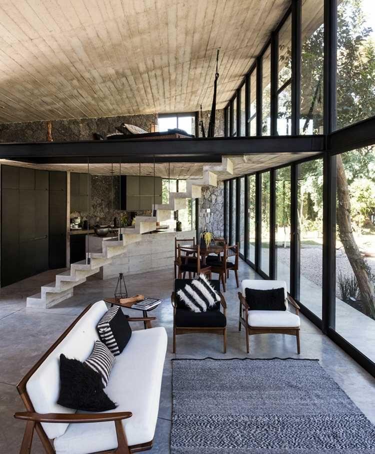 Mur de pierre et parement en béton d\u0027une maison design au Mexique