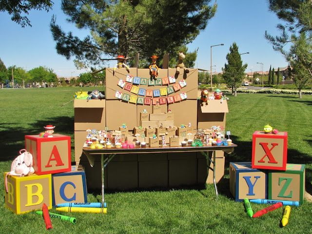 Make giant building blocks with cardboard boxes, wood letters and duct tape! More Toy Story party inspiration! #stylishkidsparties