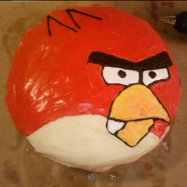 An angry bird cake for my son's 5th birthday - two layer chocolate cake with chocolate frosting between, covered with marshmallow fondant and then decorated with colored frosting