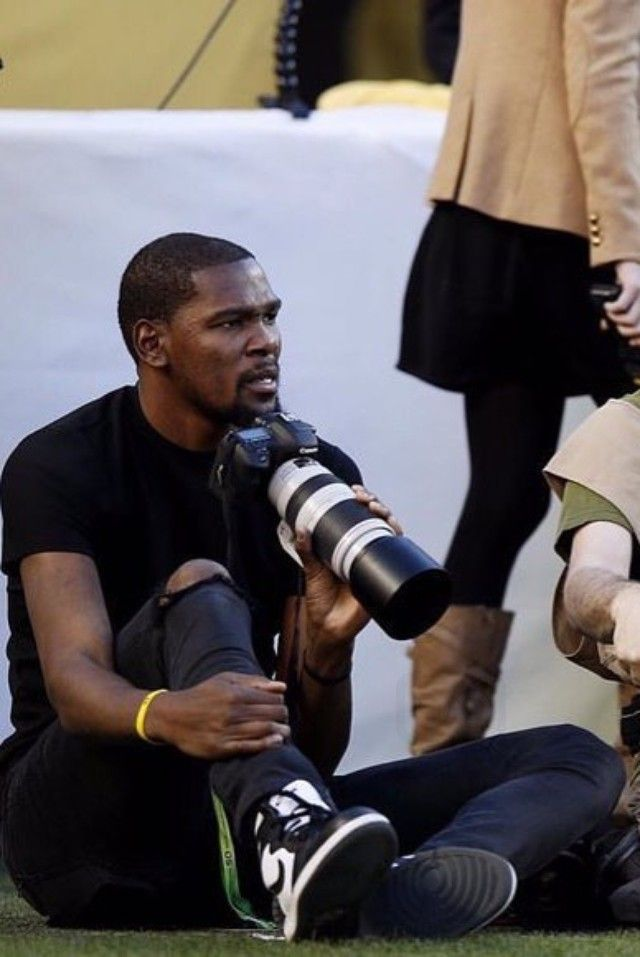03a6e43ccd57 Kevin Durant - Taking photos on the sideline at the Super Bowl 50 on ...