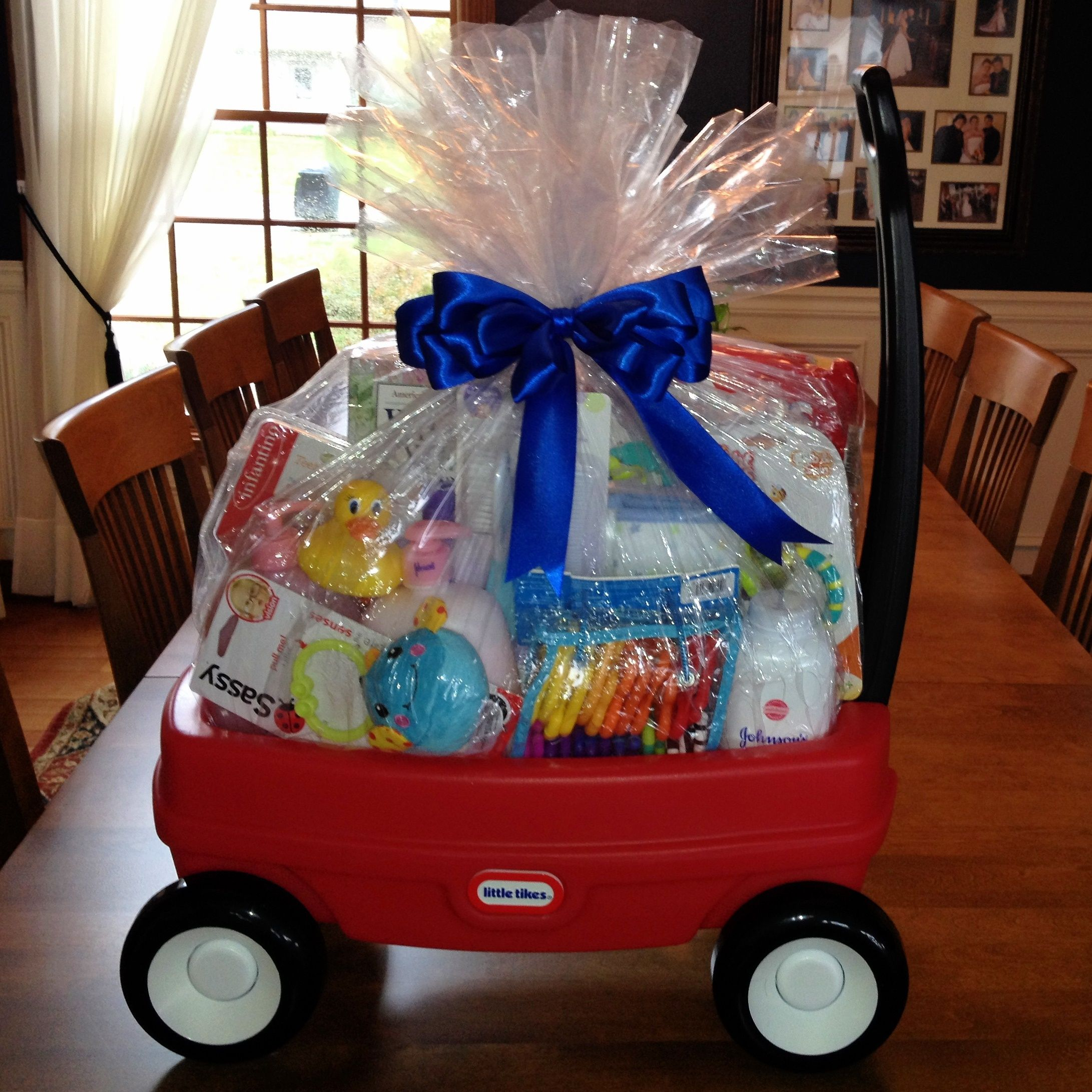 Gifts Baby Shower Kids My New Go To Baby Shower Present Basic Items From The Registry Wrapped Diy Baby Shower Gifts Baby Shower Baskets Baby Shower Presents