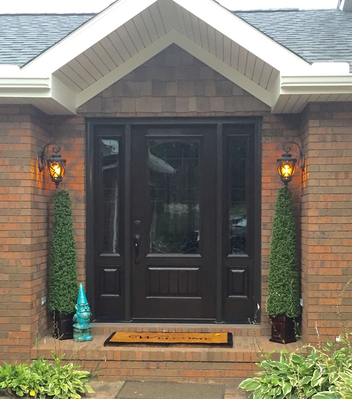 A dark ProVia front door makes a dramatic entryway against brick. We install ProVia doors in the Minneapolis area. //.replacementwindowsmpls.com & A dark ProVia front door makes a dramatic entryway against brick. We ...