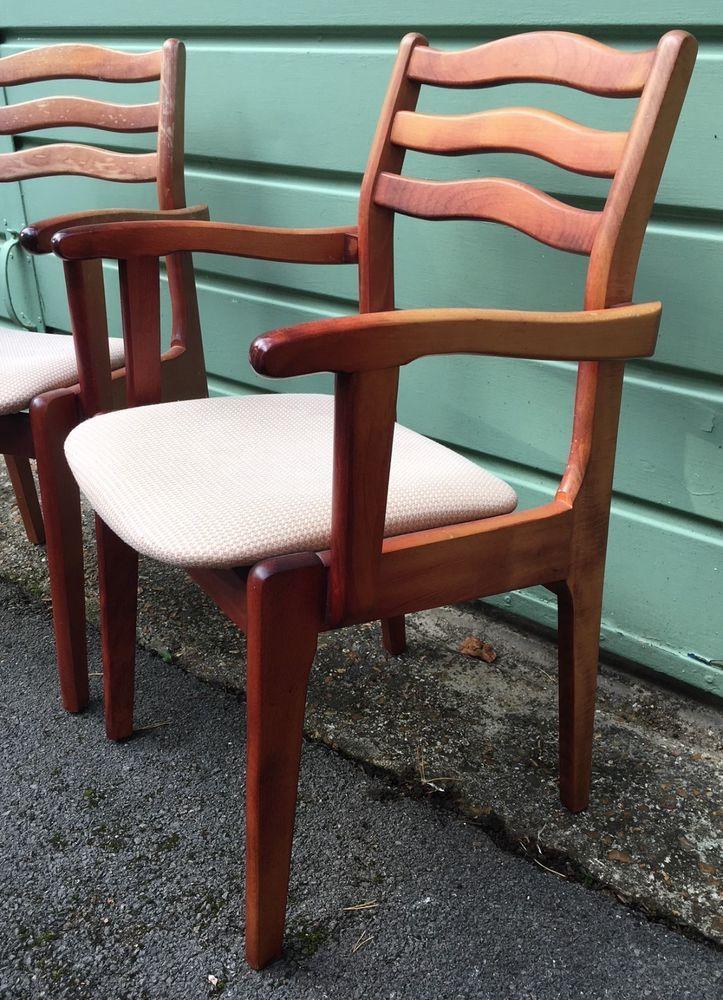 Pair of mid century unusual Danish/G Plan style carver