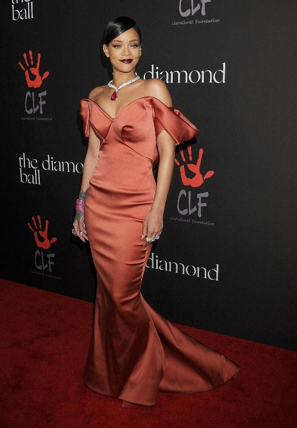 The  singer wore Zac Posen to host her first annual Diamond Ball, honoring Brad Pitt, in Beverly Hills.