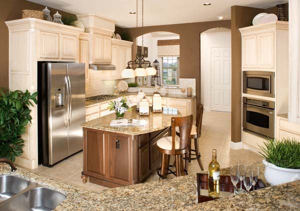 Love The Chocolate Walls With The Cream Cabinets Cosy Kitchen Home Kitchen Remodel