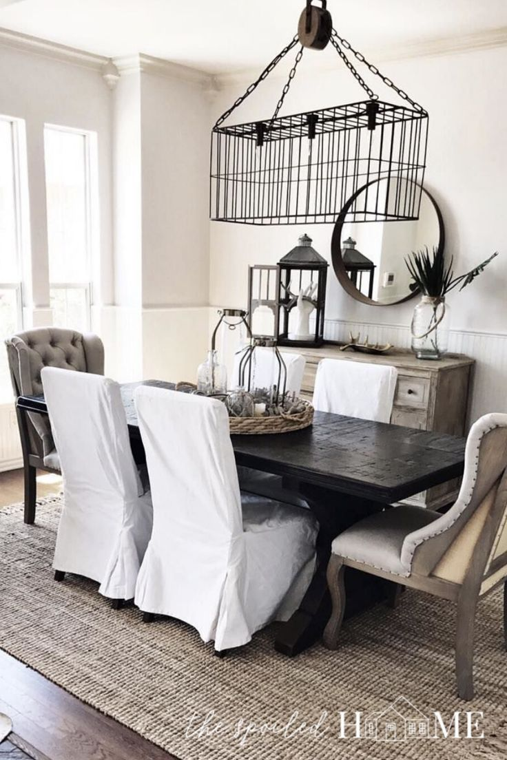 The dining room is the first room people see when they enter my house.  It is also one of the most boring rooms in our house.  I like to make it feel new by swapping out the rug in the room.  Plus, I'm a rug hoarder.  I hate turning loose of my rugs, so swapping out rugs gives me an excuse to hang onto them. #diy #homedecor #homedecorideas #TheSpoiledHome #dining #diningroom #diningroomideas #diningroomdecorating #diningroomdecor #diningroomdesign #rugs