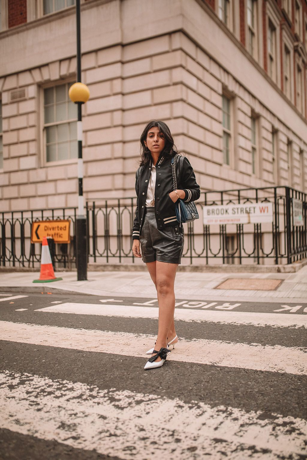 b1bb16c017d806 Luxury fashion blogger Shloka Narang of The Silk Sneaker shares how to  style a trending piece for autumn winter 2018, leather shorts, featuring  Chanel, ...