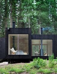 tiny glass house in the woods