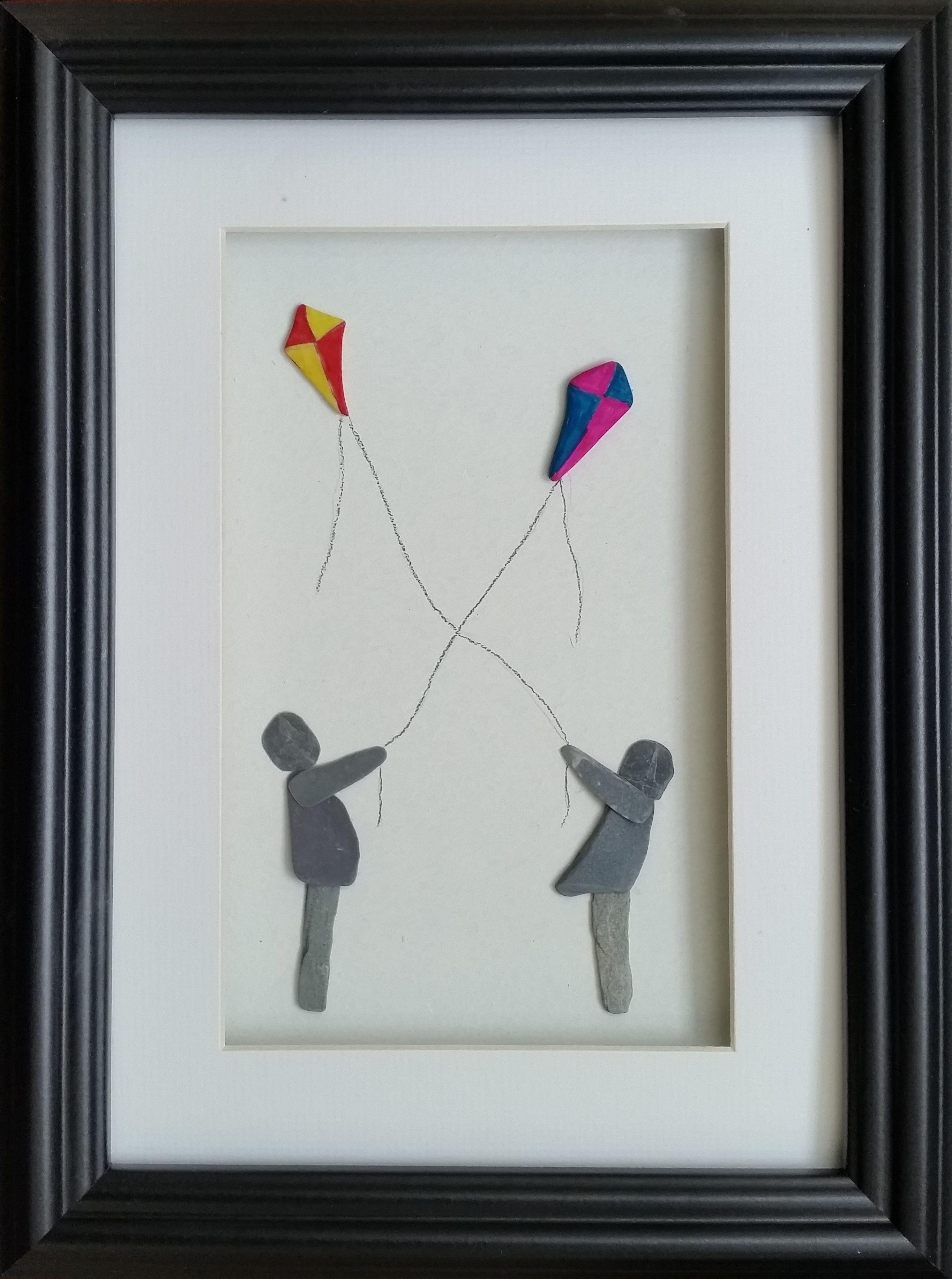 Kite Flyers https://www.etsy.com/uk/listing/523852101/kite-flying-pebble-art-picture-cornish?ref=listing-shop-header-0