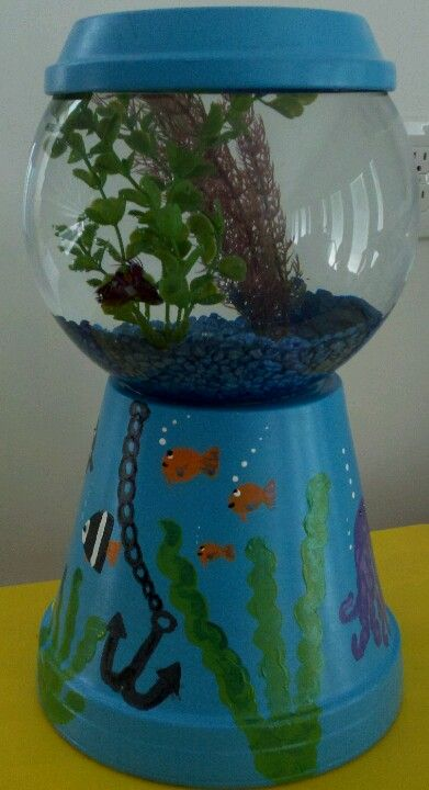 DIY fish tank! All you need is a bowl, flower pot and paint! Add fish and your done! Super cheap and super easy!