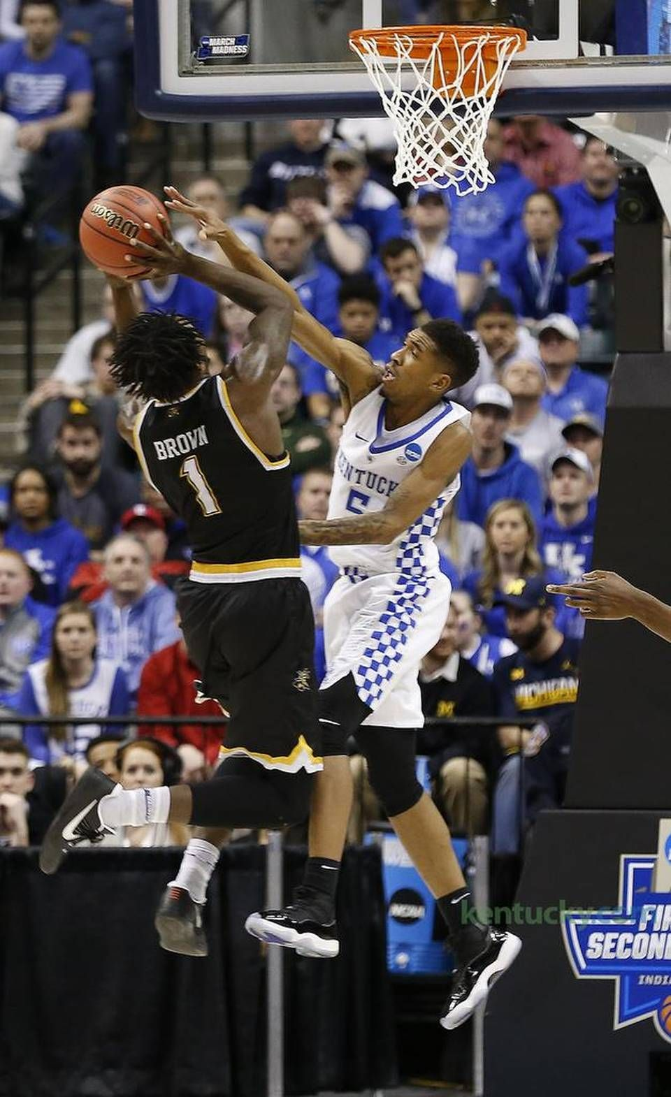 Kentucky Wildcats Guard Malik Monk 5 Blocked A Shot By Wichita State Shockers Forward Zach Brown 1 As The University Of Kentucky Played Wichita State In The
