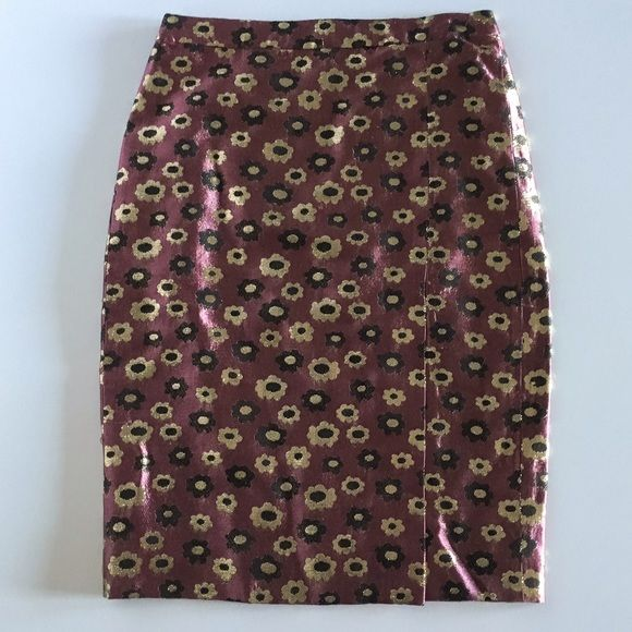 J.Crew Collection Pencil Skirt Metallic Marigold Authentic J.Crew Collection Pencil Skirt in Metallic Marigold Print Size 0. The floral jacquard color is dark quartz (dark pink/burgundy/red/plum) and has black and gold. Bought for $228 at jcrew.com. Worn once. Looks great with shell pink, black or white.  Skirt is 23 inches long (jcrew.com says 24 inches, but that is the average for this skirt -- size 0 is a bit shorter). Waist of skirt is 28 inches. Widest part around skirt at hips is 36…