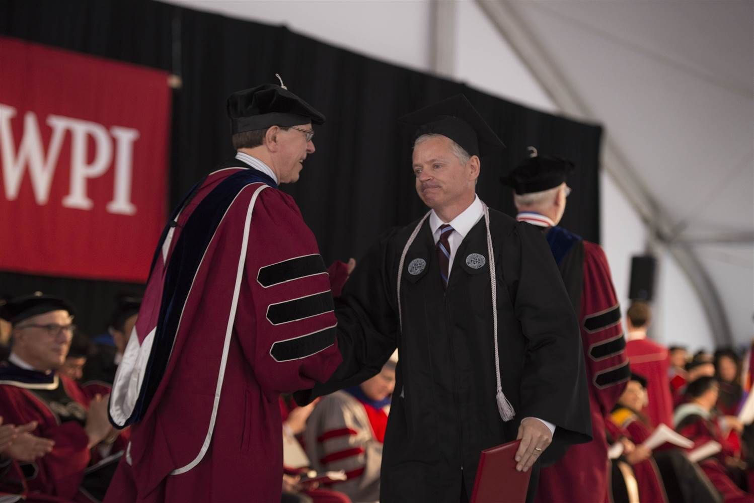 Custodian, 54, Graduates After 8 Years of Cleaning College