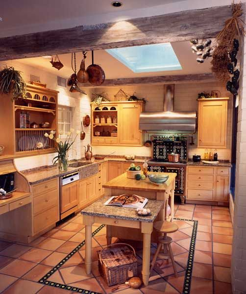 Country Kitchen With Maple Shaker Cabinets And Terra Cotta
