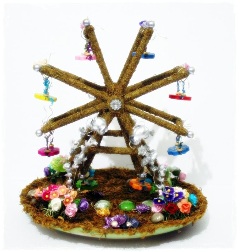 Miniature ferris wheel I made from round wooden sticks, a ...