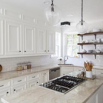 White And Cream Kitchen With Taj Mahal Counters Transitional